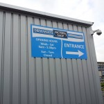 Large aluminium panel secured to unit cladding